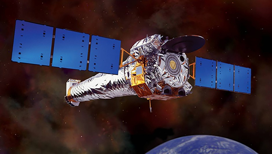 An artist's impression of the Chandra X-ray Observatory in orbit around Earth. X-ray enables astronomers to see things in the Universe that would be invisible in optical light. This NASA telescope was used to carry out follow-up observations that revealed the hidden galaxy clusters. Credit: NASA