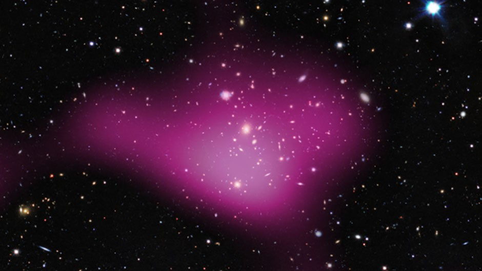 """Dark matter: an """"embarrassment""""? This image shows the calculated presence of dark matter, represented in pink, as detected by the Kilo-Degree Survey. Credit: Kilo-Degree Survey Collaboration/A. Tudorica & C. Heymans/ESO"""