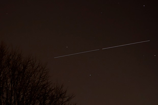 The Space Station and Shuttle Discovery pass overhead, as captured by Will Gater