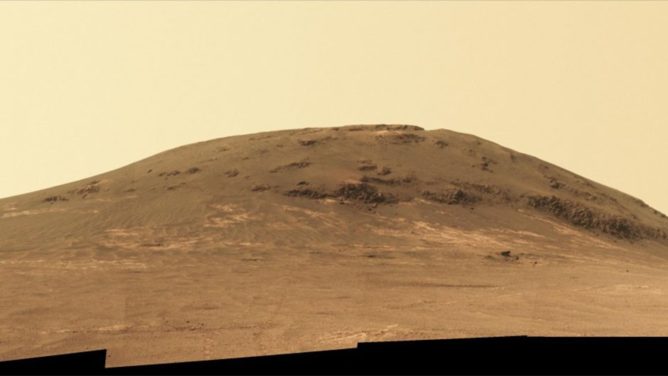 This image shows Opportunity's view as it looked back on Cape Tribulation, a raised segment of Endeavour Crater's rim. After working for 30 months at this location, it departed in April 2017 and headed southward.There are four sections making up this image, as seen by the black lines at the bottom. In the middle of the second section from the right can be seen Opportunity's wheel tracks as it roved away from the rim. For scale the distance between the two tracks is about 1 metre. Credit: NASA/JPL-Caltech/Cornell/Arizona State Univ.