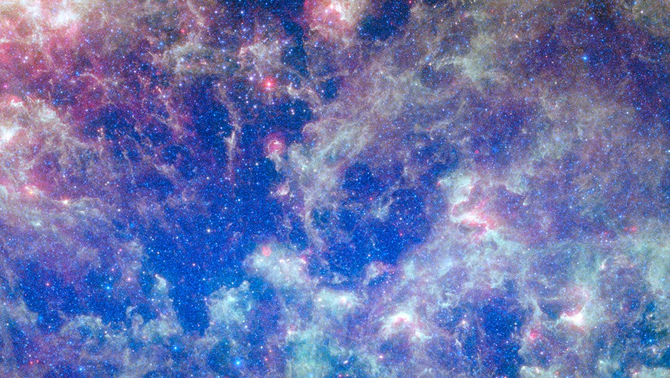This vibrant image from NASA's Spitzer Space Telescope shows the Large Magellanic Cloud, a satellite galaxy to our own Milky Way galaxy.The infrared image, a mosaic of 300,000 individual tiles, offers astronomers a unique chance to study the lifecycle of stars and dust in a single galaxy. Nearly one million objects are revealed for the first time in this Spitzer view, which represents about a 1,000-fold improvement in sensitivity over previous space-based missions. Most of the new objects are dusty stars of various ages populating the Large Magellanic Cloud; the rest are thought to be background galaxies. The blue color in the picture, seen most prominently in the central bar, represents starlight from older stars. The chaotic, bright regions outside this bar are filled with hot, massive stars buried in thick blankets of dust. The red color around these bright regions is from dust heated by stars, while the red dots scattered throughout the picture are either dusty, old stars or more distant galaxies. The greenish clouds contain cooler interstellar gas and molecular-sized dust grains illuminated by ambient starlight. Astronomers say this image allows them to quantify the process by which space dust the same stuff that makes up planets and even people is recycled in a galaxy. The picture shows dust at its three main cosmic hangouts: around the young stars, where it is being consumed (red-tinted, bright clouds); scattered about in the space between stars (greenish clouds); and in expelled shells of material from old stars (randomly-spaced red dots). The Large Magellanic Cloud, located 160,000 light-years from Earth, is one of a handful of dwarf galaxies that orbit our own Milky Way. It is approximately one-third as wide as the Milky Way, and, if it could be seen in its entirety, would cover the same amount of sky as a grid of about 480 full moons. About one-third of the entire galaxy can be seen in the Spitzer image. This picture is a composite of infrared li