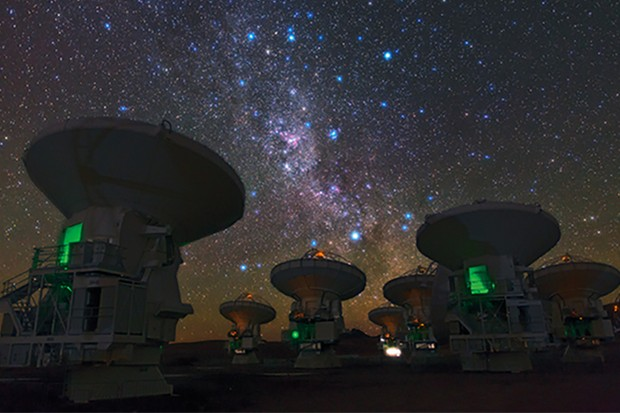 "ESO Photo Ambassador Babak Tafreshi snapped this remarkable image of the antennas of the Atacama Large Millimeter/submillimeter Array (ALMA), set against the splendour of the Milky Way. The richness of the sky in this picture attests to the unsurpassed conditions for astronomy on the 5000-metre-high Chajnantor plateau in Chile's Atacama region. This view shows the constellations of Carina (The Keel) and Vela (The Sails). The dark, wispy dust clouds of the Milky Way streak from middle top left to middle bottom right. The bright orange star in the upper left is Suhail in Vela, while the similarly orange star in the upper middle is Avior, in Carina. Of the three bright blue stars that form an ""L"" near these stars, the left two belong to Vela, and the right one to Carina. And exactly in the centre of the image below these stars gleams the pink glow of the Carina Nebula (eso1208). ESO, the European partner in ALMA, is providing 25 of the 66 antennas that will make up the completed telescope. The two antennas closest to the camera, on which the careful viewer can find the markings ""DA-43"" and ""DA-41"", are examples of these European antennas. Construction of the full ALMA array will be completed in 2013, but the telescope is already making scientific observations with a partial array of antennas. Babak Tafreshi is founder of The World At Night, a programme to create and exhibit a collection of stunning photographs and time-lapse videos of the world's most beautiful and historic sites against a night-time backdrop of stars, planets and celestial events. ALMA, an international astronomy facility, is a partnership of Europe, North America and East Asia in cooperation with the Republic of Chile. ALMA construction and operations are led on behalf of Europe by ESO, on behalf of North America by the National Radio Astronomy Observatory (NRAO), and on behalf of East Asia by the National Astronomical Observatory of Japan (NAOJ). The Joint ALMA Observatory (JAO) prov"