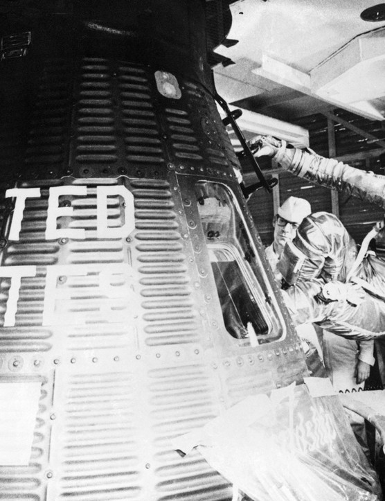 John Glenn enters the 'Friendship 7' spacecraft during launch preparations for the Mercury-Atlas 6 (MA-6) mission that would make him the first American to orbit the Earth, February 1962. (Credit: NASA)