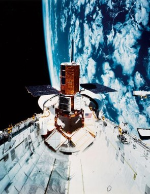 The 'Canadarm' robotic arm operates on the US Space Shuttle.