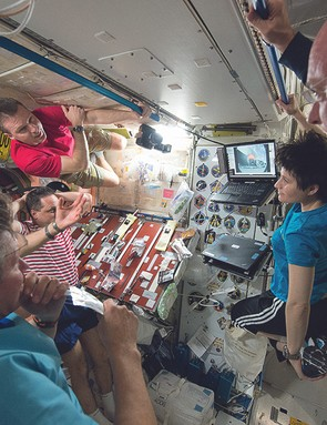 Getting together in Node 1 to watch the launch of the SpaceX resupply rocket on a laptop streaming live from the ground. (ESA astronaut) Samantha Cristoforetti (pictured here left of Kelly) will grab the capsule a few days later from the U.S. cupola module.