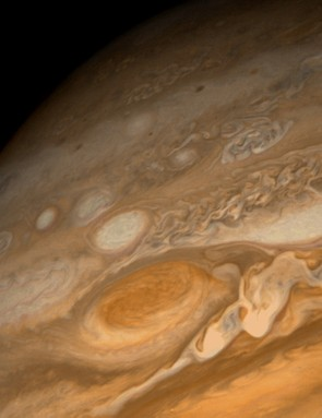 Jupiter's Great Red Spot captured by Voyager 1 in February 1979, at a distance of 9.2 million km. The wavy cloud pattern to the right of the Red Spot is variable wave motion in the atmosphere; evidence of large-scale storms. (Credit: NASA/JPL)
