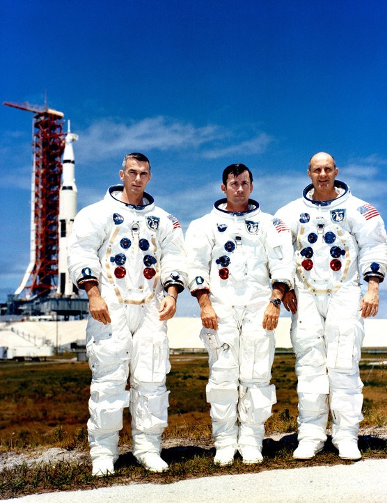 From left, Eugene Cernan, John Young and Thomas Stafford at Kennedy Space Center having just completed a test exercise for their Apollo 10 mission on 13 May 1969. The rocket that would take the three astronauts on their mission can be seen in the background. (NASA)