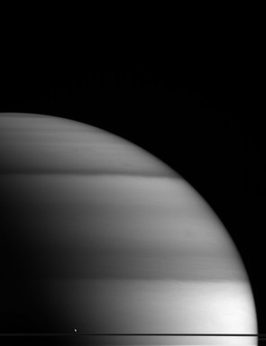25th May 2015. Enceladus appears to sit on top of Saturn's rings, with the vastness of the planet behind it. (Credit: NASA/JPL-Caltech/Space Science Institute)