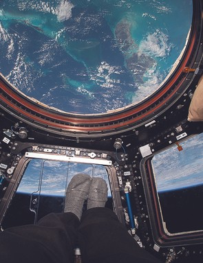 """In the cupola, over the Bahamas. With the growing trend of feet photos on Instagram, I decided to turn myself so my feet were pointing toward Earth as I snapped this photo to share my unique point of view from our """"glass bottom boat"""" in space."""