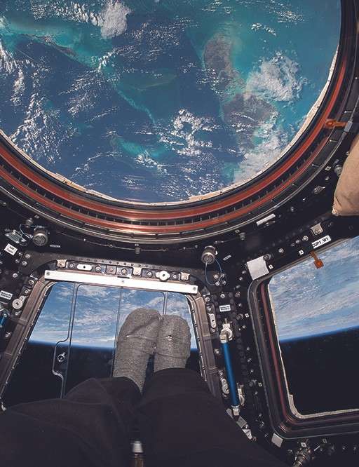 "In the cupola, over the Bahamas. With the growing trend of feet photos on Instagram, I decided to turn myself so my feet were pointing toward Earth as I snapped this photo to share my unique point of view from our ""glass bottom boat"" in space."