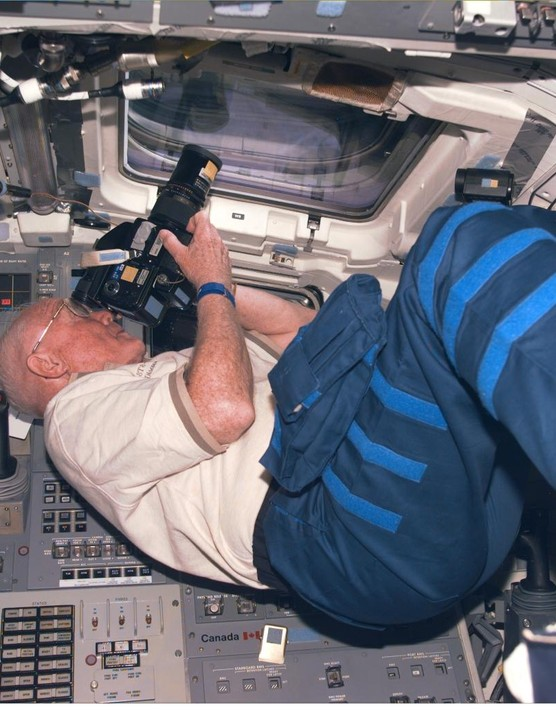 Participating in Earth observations onboard the Space Shuttle Discovery during the mission that made Glenn the oldest person to fly in space aged 77, 31 October 1998. (Credit: NASA)