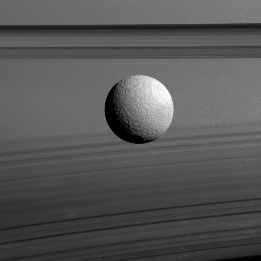 23rd November 2015. Saturn's moon Tethys floating in the foreground of its parent planet. The moon is composed mainly of water ice, much like the rings of Saturn. (Credit: NASA/JPL-Caltech/Space Science Institute)