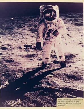 The famous photo of Buzz Aldrin walking on the surface of the Moon, captured by Neil Armstrong.