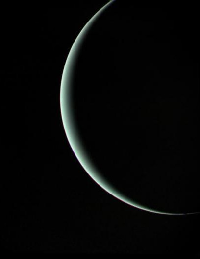 Farewell shot of the crescent Uranus as Voyager 2 heads towards Neptune in 1986. Despite the limited light on the planet, Uranus maintains its blue-green colour, resulting from methane in its atmosphere.(Credit: NASA/JPL)