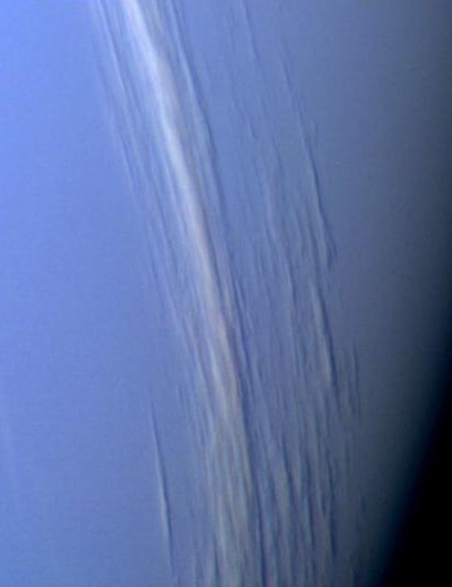 High-altitude cloud streaks in Neptune's atmosphere. This image was taken by Voyager 2 two hours before its closest approach to the planet. The clouds lie approximately along lines of constant latitude and are from 50-200km wide. (Credit: NASA/JPL)