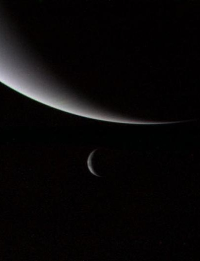 The dramatic view of Neptune and Triton (its largest moon) as crescents, captured as Voyager 2 flew away from the planet. The spacecraft was 4.8 million km away and heading out of the Solar System. (Credit: NASA/JPL)