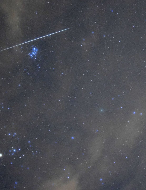 Geminid meteor and Comet 46P in Taurus  Marc Charron, Ayr, 13 December 2018  Equipment: Nikon D5300 DSLR camera, Nikkor 28mm f/2.8 lens.