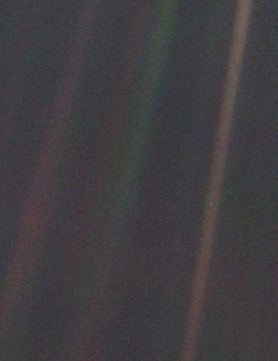 This is the Pale Blue Dot, part of the 'family portrait' of the Solar System taken by Voyager 1 looking towards Earth from a distance of 6 billion km. The Earth appears as a tiny speck at the centre of one of the rightmost scattered sunbeams. (Credit: NASA/JPL)