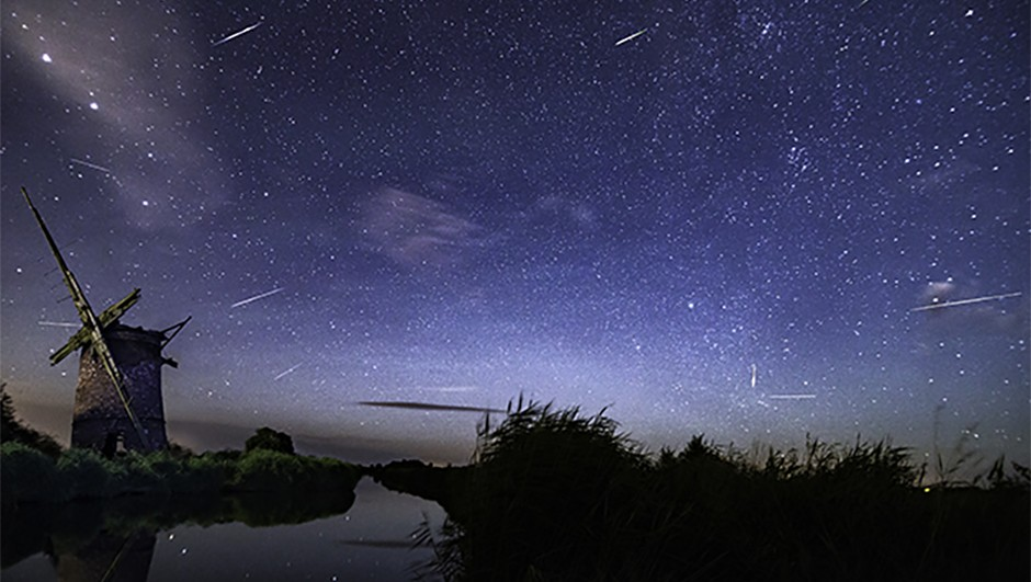 """Ben Gadsby-Williams took this image of a meteor shower on 12 August 2016 from Brograve Mill in Norfolk, showing the importance of a good location to astrophotography. Ben says: """"I was impressed by low light pollution and peacefulness. I didn't see anyone else all night, only a few distant lights from cars passing.""""Ben used a Canon EOS 6D DSLR camera and Tokina 11-16mm lens. Credit: Ben Gadsby-Williams"""
