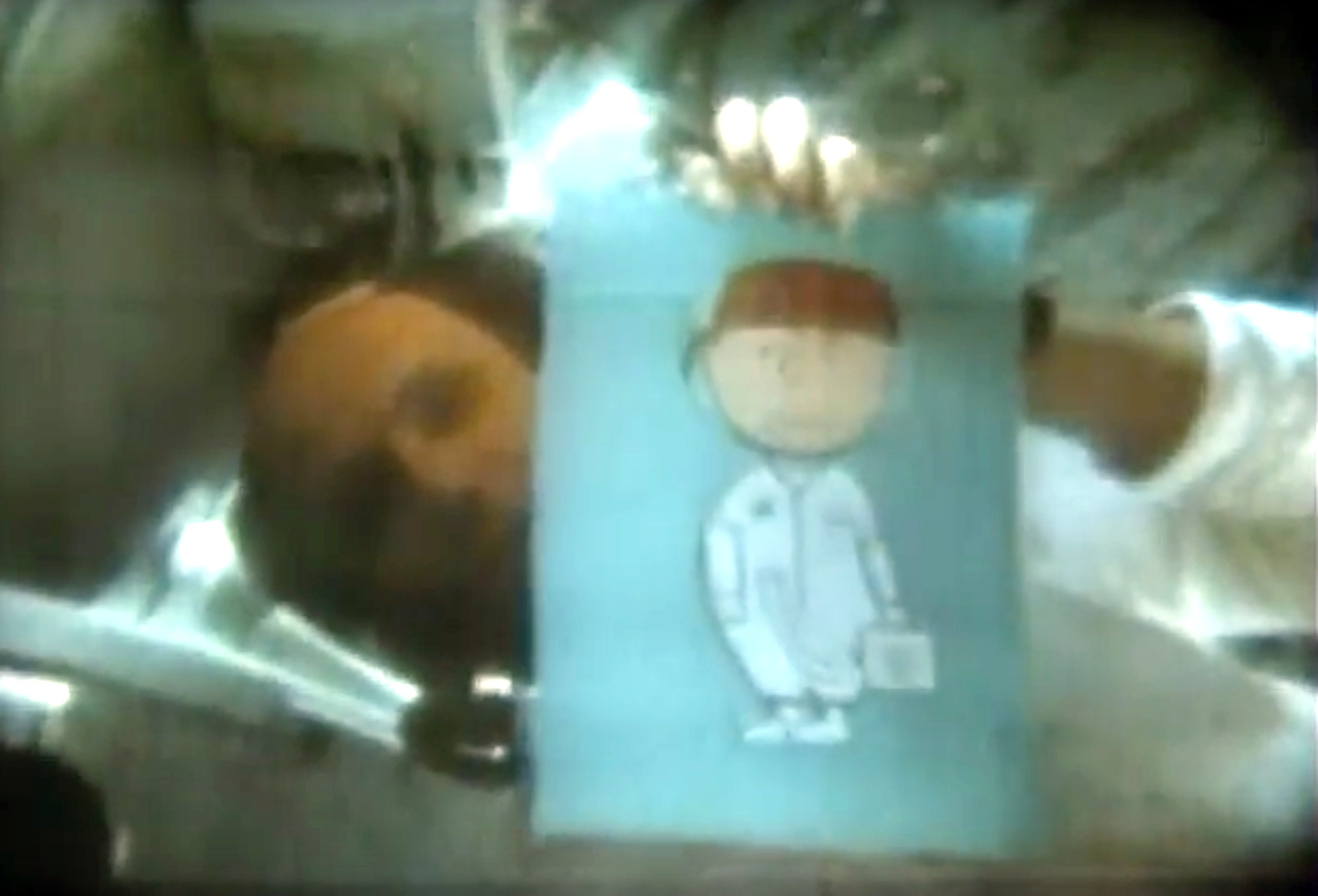 Þ Thomas Stafford holds up a picture of Charlie Brown in a spacesuit to the camera during a TV transmission. Credit: NASA