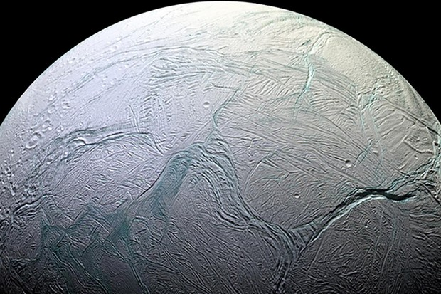 The cratered moon Enceladus. Cassini data has revealed a subsurface ocean beneath its icy crust. Credit: NASA/JPL-Caltech/Space Science Institute