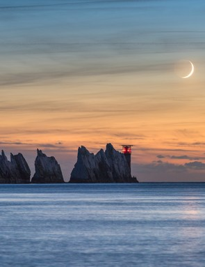 Crescent Moon over the Needles Ainsley Bennett (UK)   Location: Alum Bay, Freshwater, Isle of Wight, UK, 3 October 2016  Equipment: Nikon D810 DSLR camera, 200mm f/5.6 lens.