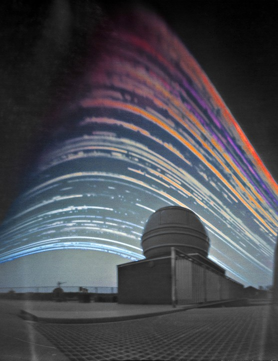 Solar Trails above the Telescope Maciej Zapior (Poland)   Location: Astronomical Institute of the Czech Academy of Sciences, Prague  Equipment: Home-made Solargraph pinhole camera, 6-month exposure