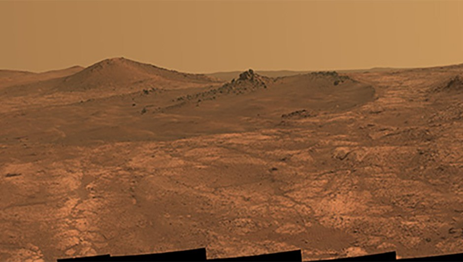 The elongated crater 'Spirit of St. Louis' can be seen in this image of the Martian surface, as seen by NASA's Mars Exploration Rover Opportunity.  Do asteroids and comets deliver a substantial amount of organics to the Martian surface? Credits: NASA/JPL-Caltech/Cornell Univ./Arizona State Univ