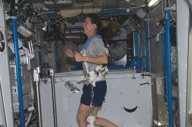 ISS crew memebers keep fit with two hours of mandatory exercise on a treadmill each day  Credit: NASA