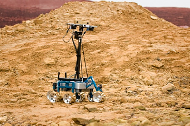 "Robotic rover ""indie"" being tested on the simulated martain landscape at the ATLAS, R27, quadrangle at STFC's Rutherford Appleton Laboratory under an ESA contract, 8th December 2011."