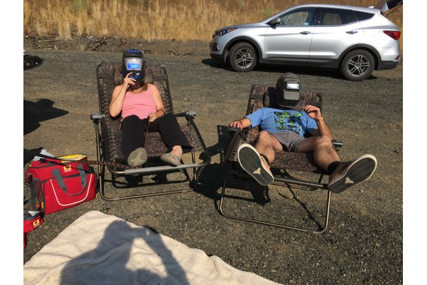 Welders' masks at the ready, totality begins! Credit: Nick Spall.