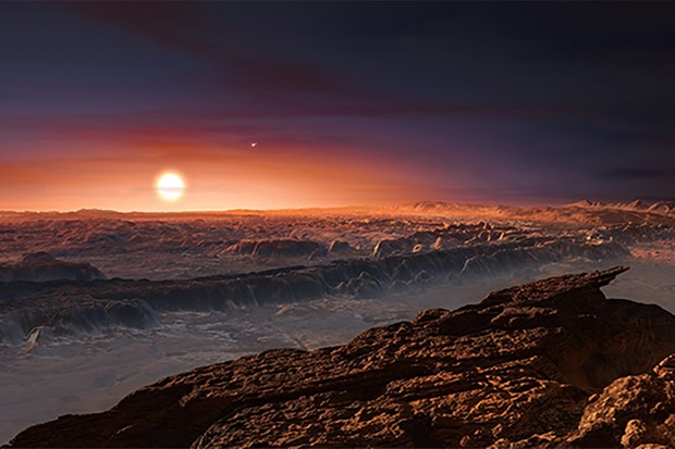 An artist's impression of the surface of exoplanet Proxima b orbiting the red dwarf star Proxima Centauri. Credit: ESO/M. Kornmesser