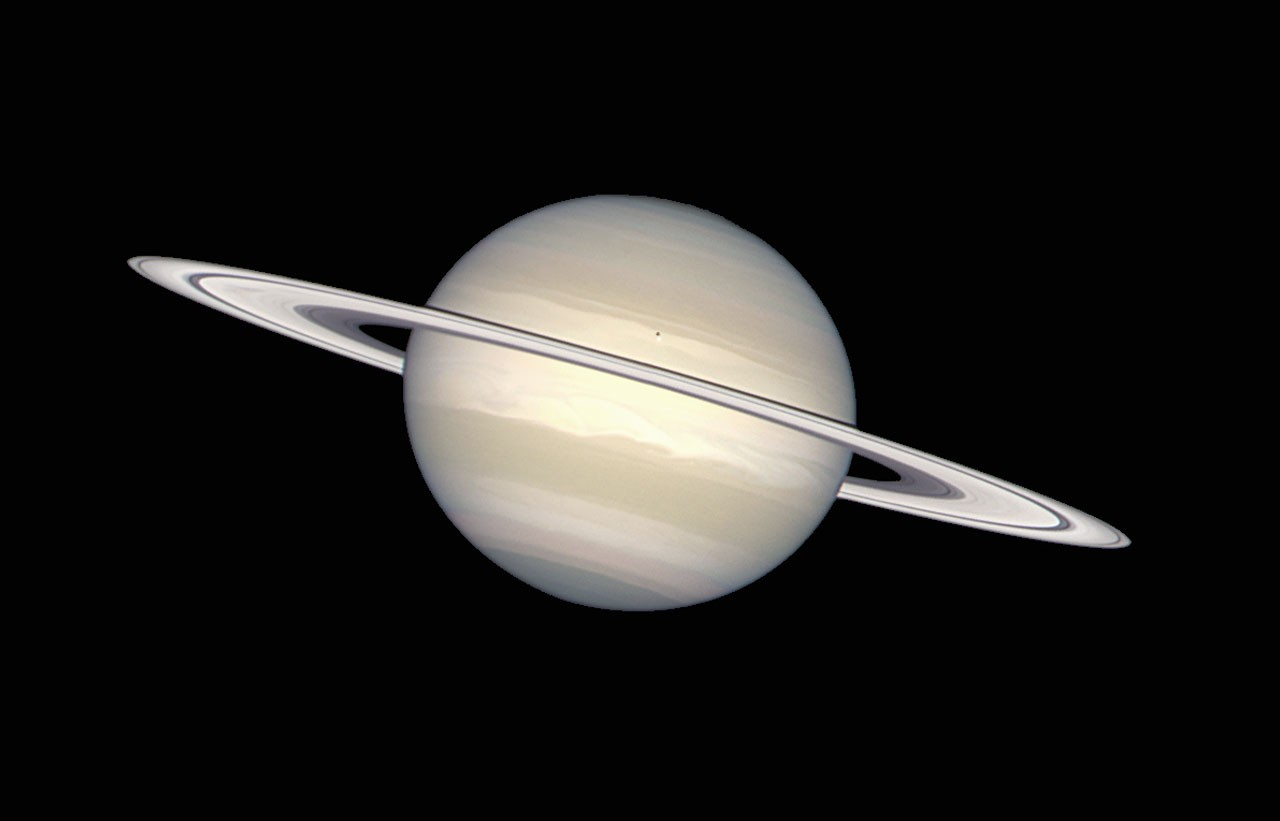 The NASA/ESA Hubble Space Telescope has provided images of Saturn in many colors, from black-and-white, to orange, to blue, green, and red. But in this picture, image processing specialists have worked to provide a crisp, extremely accurate view of Saturn, which highlights the planet's pastel colors. Bands of subtle colour - yellows, browns, grays - distinguish differences in the clouds over Saturn, the second largest planet in the solar system.
