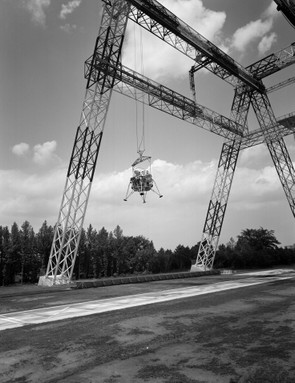 Lunar landing testing, 18 June 1965. Here, NASA test the landing procedures of a lunar module. The 75m high and 122m long gantry structure became active in 1965 and was used extensively during the Apollo programme. Credit: NASA