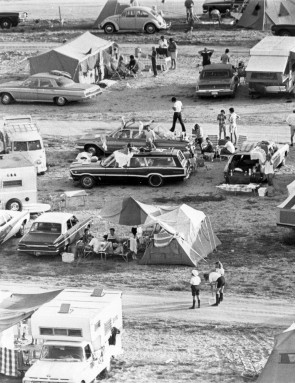 Apollo 11 spectators assemble, July 16, 1969. Pictured is a snippet of the crowds that gathered on roadsides and beaches close to NASA Kennedy Space Center to watch the Apollo 11 launch. Many had camped the night before to ensure they secured a good spot. Credit: NASA