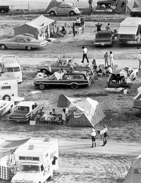 Apollo 11 spectators assemble,July 16, 1969. Pictured is a snippet of the crowds that gathered on roadsides and beaches close to NASA Kennedy Space Center to watch the Apollo 11 launch. Many had camped the night before to ensure they secured a good spot.Credit: NASA