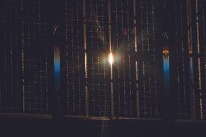 The setting Sun peeks through the solar arrays of the Russian Soyuz spacecraft.