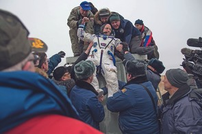 Expedition 46 Commander Scott Kelly of NASA is helped out of the Soyuz TMA-18M spacecraft just minutes after he and Russian cosmonauts Mikhail Kornienko and Sergey Volkov of Roscosmos landed in a remote area near the town of Zhezkazgan, Kazakhstan on Wednesday, March 2, 2016 (Kazakh time). Kelly and Kornienko completed an International Space Station record year-long mission to collect valuable data on the effect of long duration weightlessness on the human body that will be used to formulate a human mission to Mars. Volkov returned after spending six months on the station. Photo Credit: (NASA/Bill Ingalls)