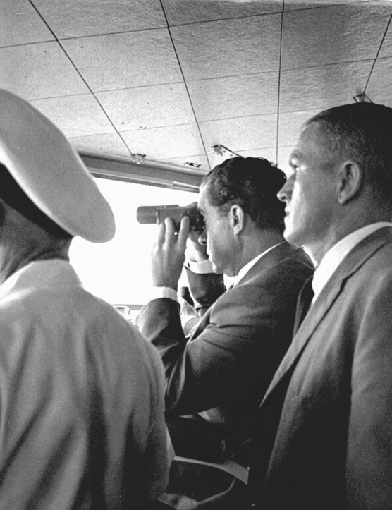 Mission recovery,July 24, 1969. US President Richard Milhous Nixon (centre) watches the recovery of the Apollo 11 Lunar Mission, aboard the USS Hornet aircraft carrier. Standing next behind Nixon (right of the image) is astronaut Frank Borman, Apollo 8 Commander. Credit: NASA