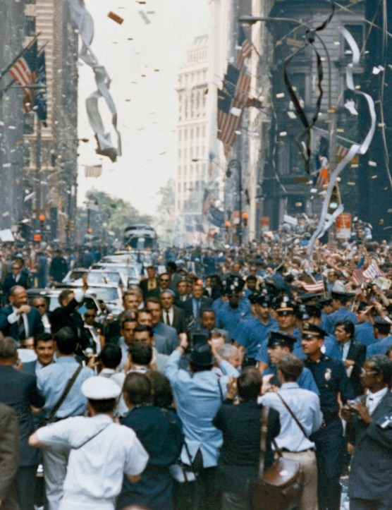 Apollo 11 New York jubilations,13 August 1969. The whole of New York City comes out to welcome the Apollo 11 crew, showering them in ticker tape. Pictured in the car, from right, are Neil Armstrong, Michael Collins and Buzz Aldrin.Credit: NASA