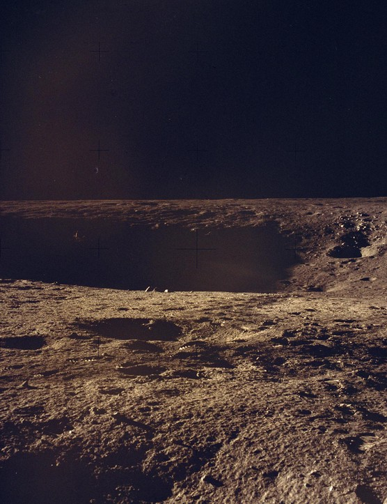 Lunar surface exploration,14 - 24 November. Apollo 12 was designed to carry out a number of lunar soil activities including the collection of 34kg of rock samples. This image was taken during the mission, showing the lunar surface and the footprints of the astronauts in the dust.Credit: NASA