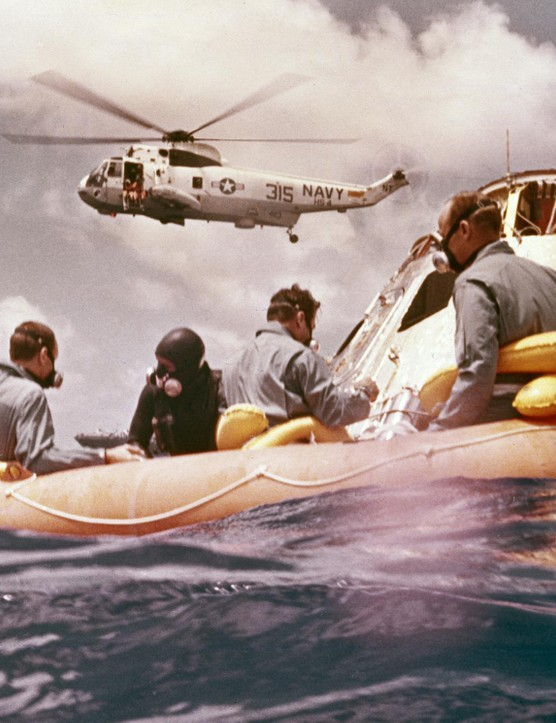 Pacific recovery,24 November 1969. The recovery of the Apollo 12 mission, the second manned mission to the Moon. Apollo 12 astronauts were Lunar Module pilot Alan L Bean, Command Module pilot Richard Gordon and Commander Charles Conrad. All three can be seen in the life raft.Credit: NASA