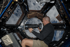 3 June 2013 - Inside the Cupola, NASA astronaut Chris Cassidy, captures a veiw of Earth some 250 miles below. Cassidy has been onboard the ISS since March and will continue his stay into September.