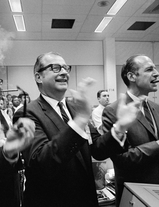 Splashdown success,17 April 1970. Staff members from NASA Headquarters Manned Spacecraft Center and Dr Thomas Paine (centre of frame) applaud the successful splashdown of the Apollo 13 mission in the south Pacific Ocean, while Dr George Low smokes a celebratory cigar (right).Credit: NASA
