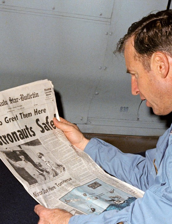 Read all about it,17 April 1970. Astronaut James A Lovell Jr, Apollo 13 mission commander, reads a newspaper article about the safe recovery of the problem-plagued mission. Credit: NASA