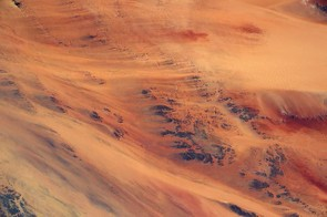 No, it's not the surface of Mars but dunes in the African desert.