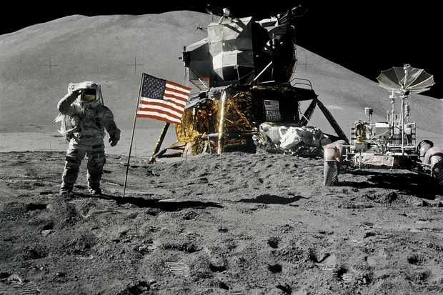 Lunar Module pilot James B Irwin gives a military salute during at the Hadley-Apennine landing site, on the Apollo 15 mission. The Lunar Module 'Falcon' is in the centre of the image and on the right is the Lunar Roving Vehicle. Credit: NASA