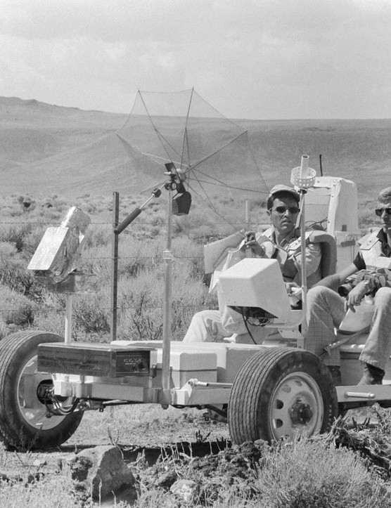 Test drive,6 September 1972. Apollo 17 Commander Eugene A Cernan (foreground) and Lunar Module pilot Harrison H Schmitt (on Cernan's right) take the Lunar Roving Vehicle trainer for a spin in the Pancake Range area of south-central Nevada.Credit: NASA