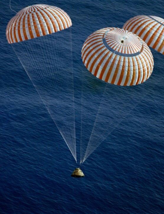The final descent,19 December 1972. The Apollo 17 Command Module, with astronauts Eugene A Cernan, Ronald E Evans and Harrison H Schmitt aboard, nears splashdown in the south Pacific Ocean, successfully drawing the Apollo programme to a close.Credit: NASA
