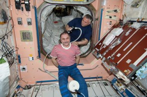 1 June 2013 - It's haircut day for Expedition 36 Commander Pavel Vinogradov, a cosmonaut with Russia's Federal Space Agency, in the ISS's Unity node.
